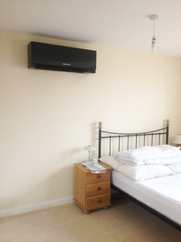 Artistic wall air conditioning unit for a bedroom