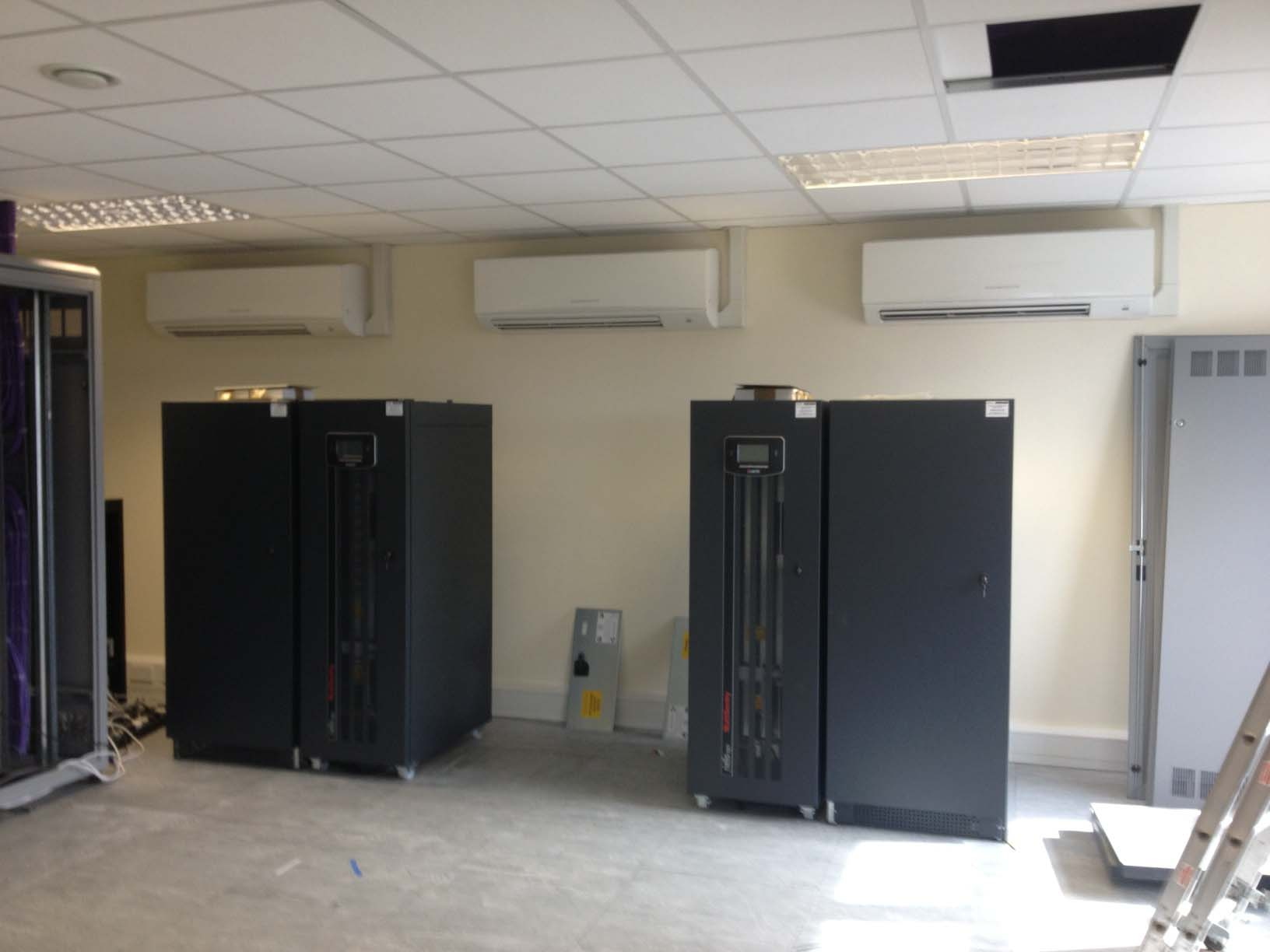 wall mounted air conditioning units mounted on the side of the server room in case of any future water failure